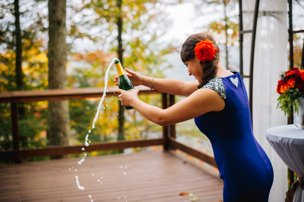 bride popping champagne smokeys on the gorge wedding photography