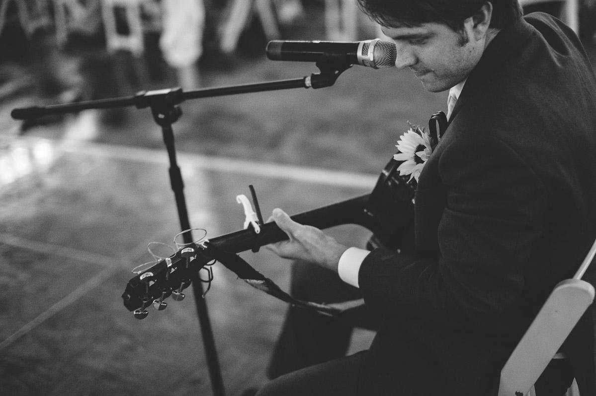 groom playing guitar singing song to bride backyard west virginia wedding reception jpg0