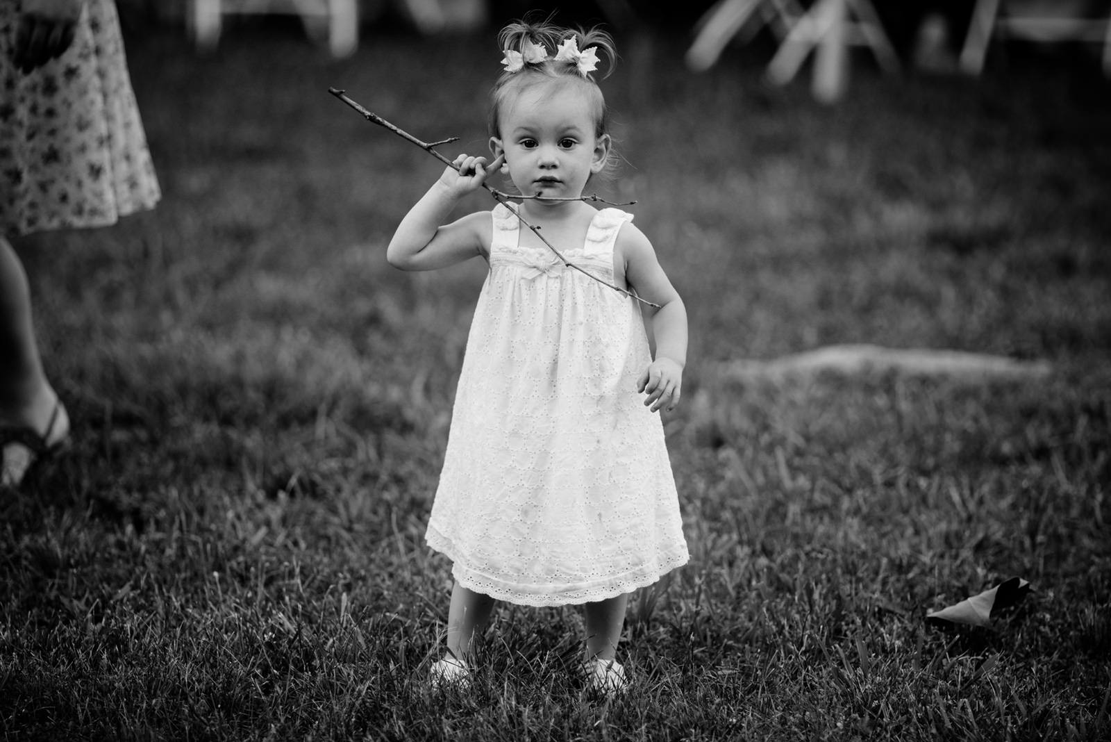 little girl finds stick