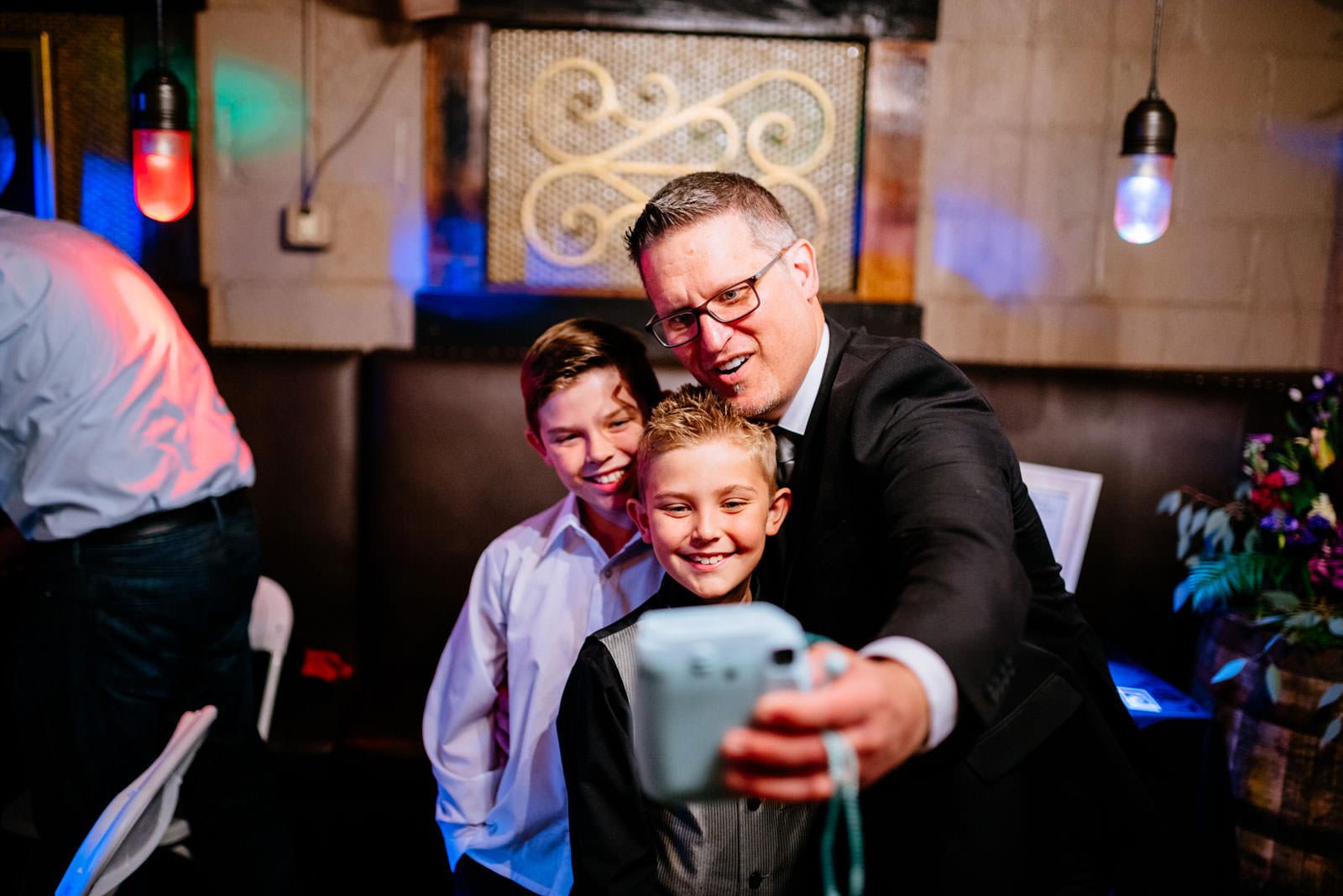 wedding guests using instax camera selfie