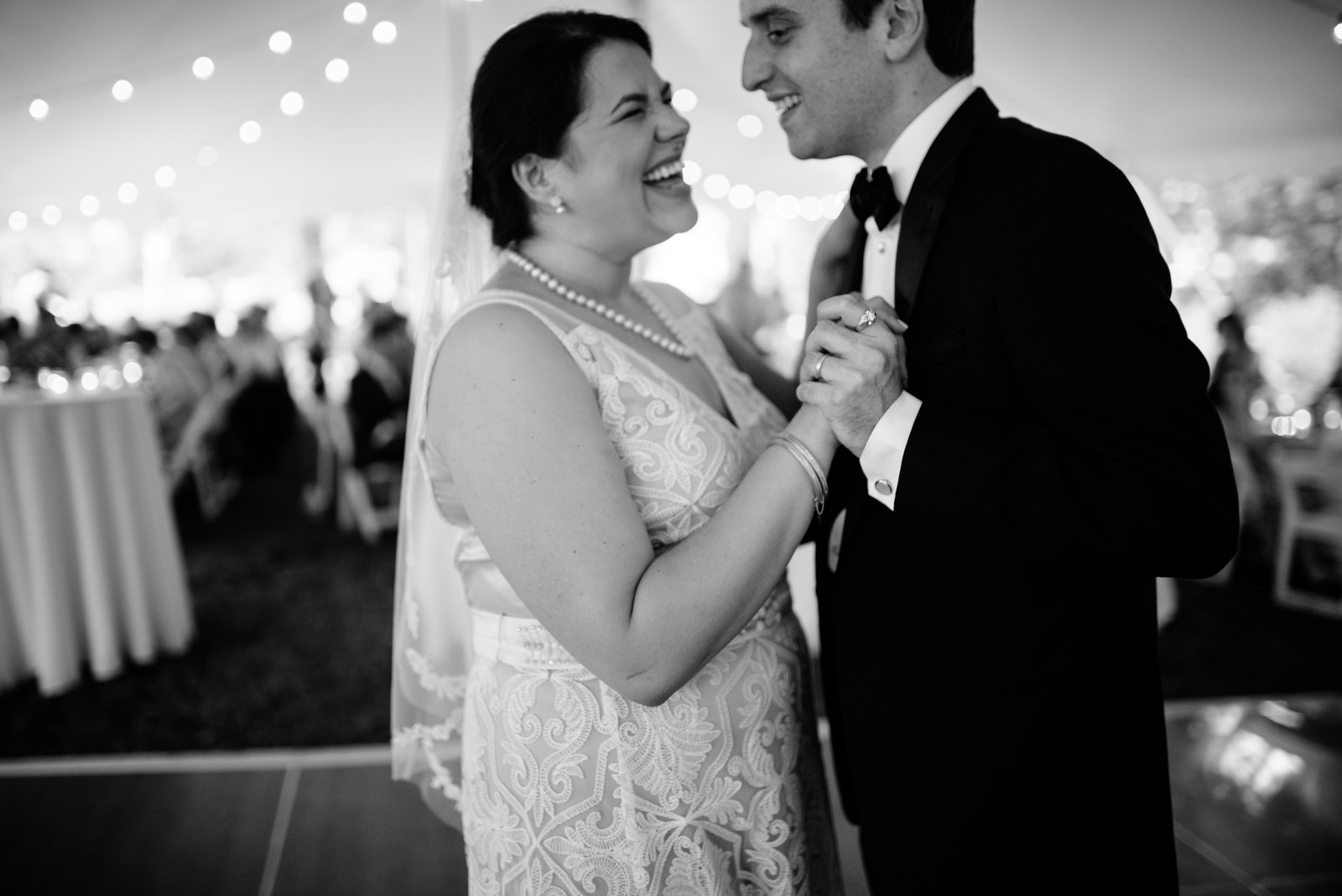 bride groom first dance mlaughing black and white wedding photography