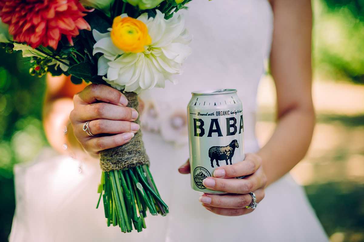 bride with bouquet and beer