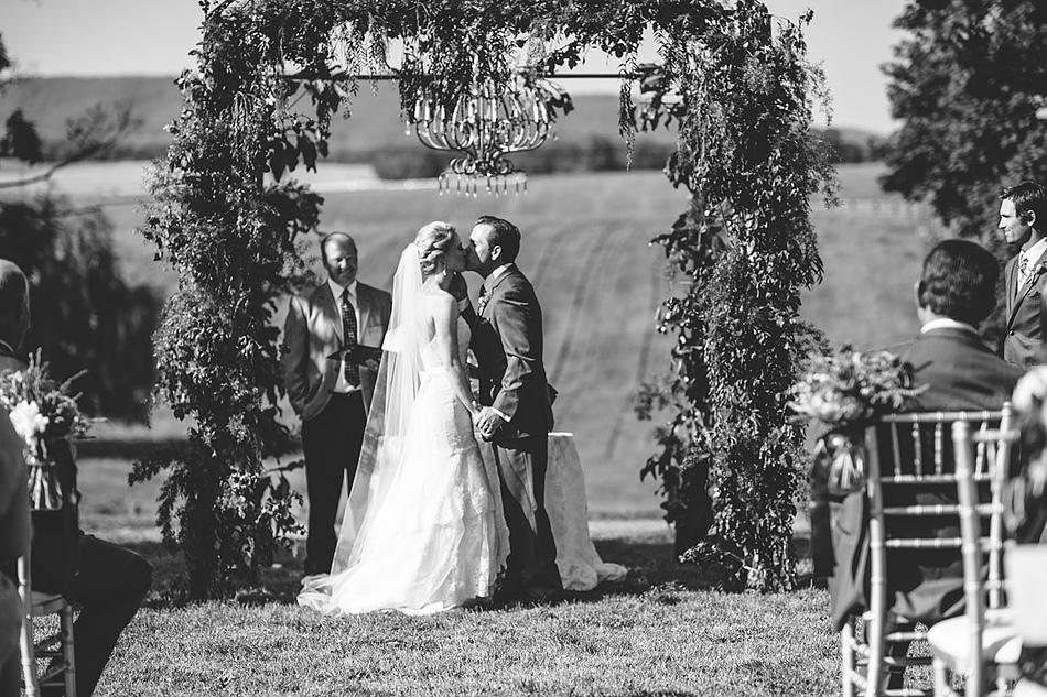 farm wedding ceremony first kiss