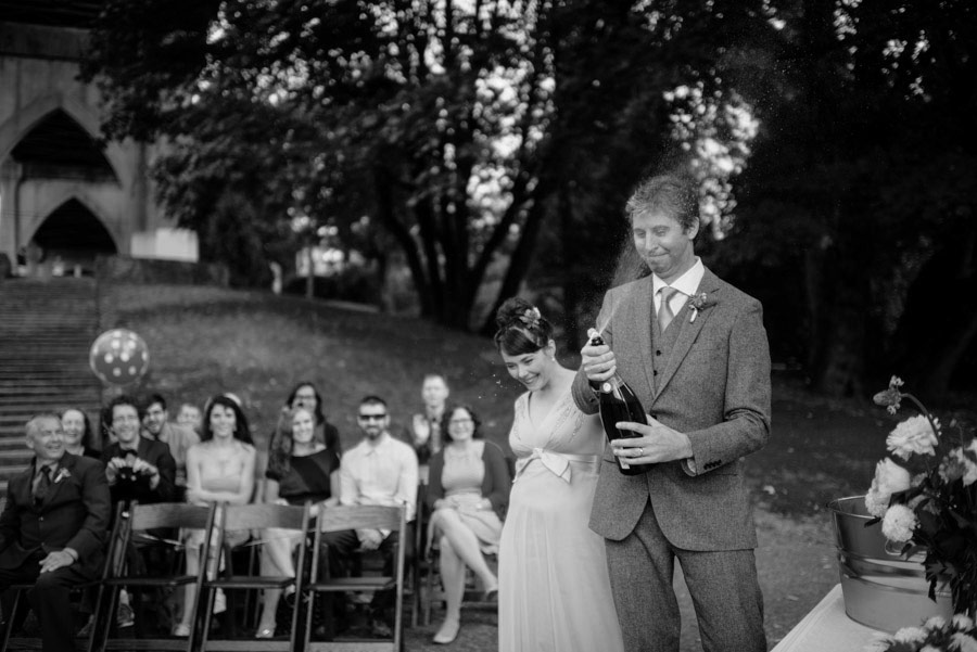 groom opening champagne funny wedding photojournalism by west virginia photographers the oberports