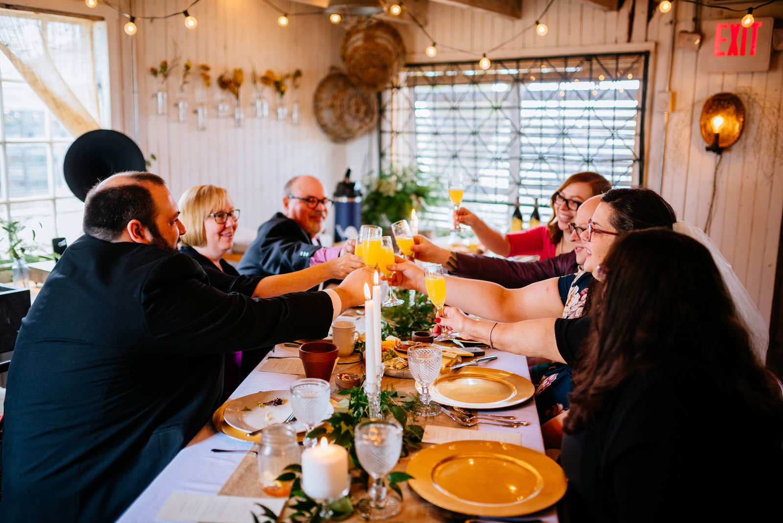 toasting mimosas terrain elopement family style brunch at mushroom house