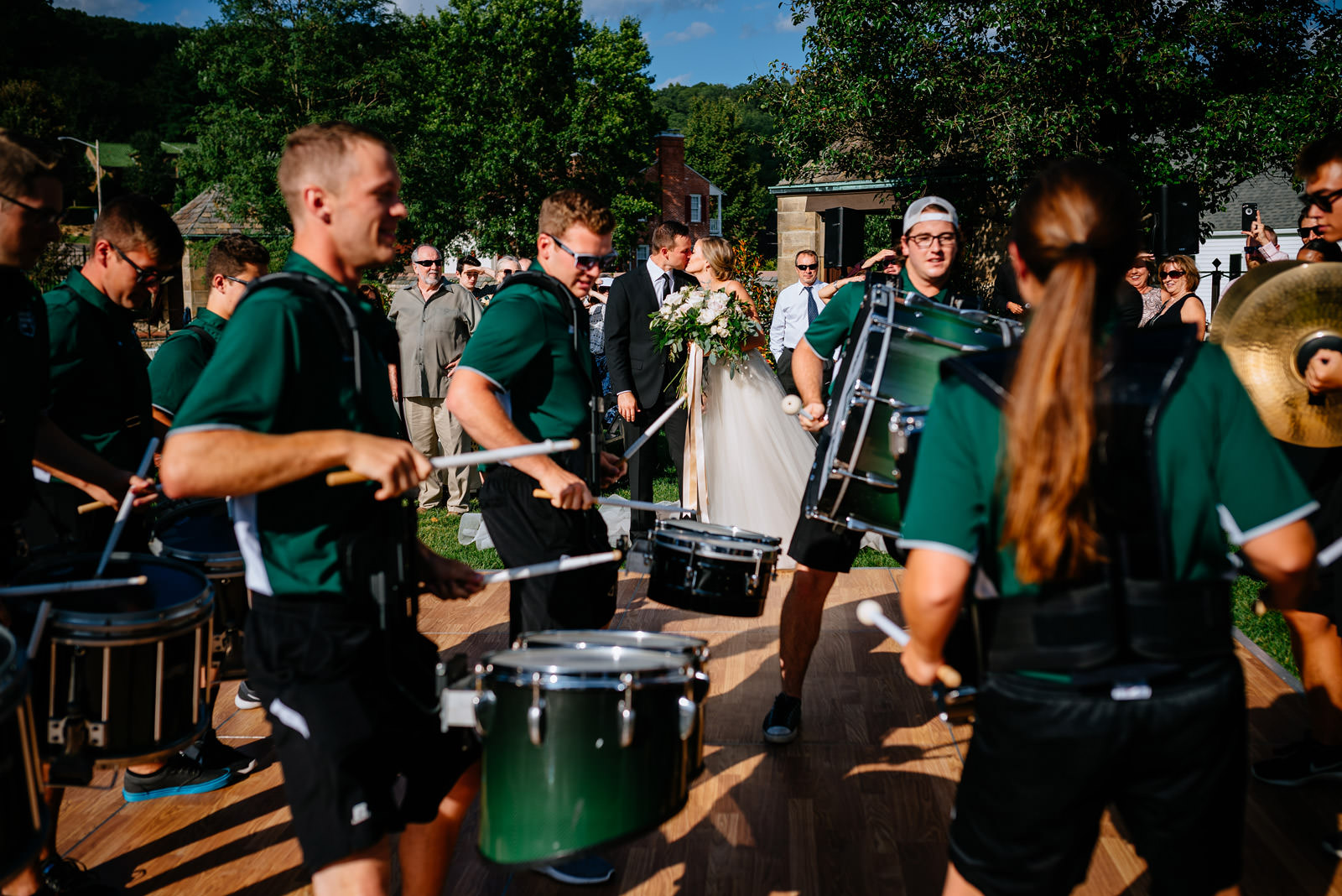 bride groom reception entrance with ohio university drumline zenner house wedding athens ohio