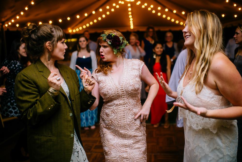bridesmaids bride dancing together wedding reception moments
