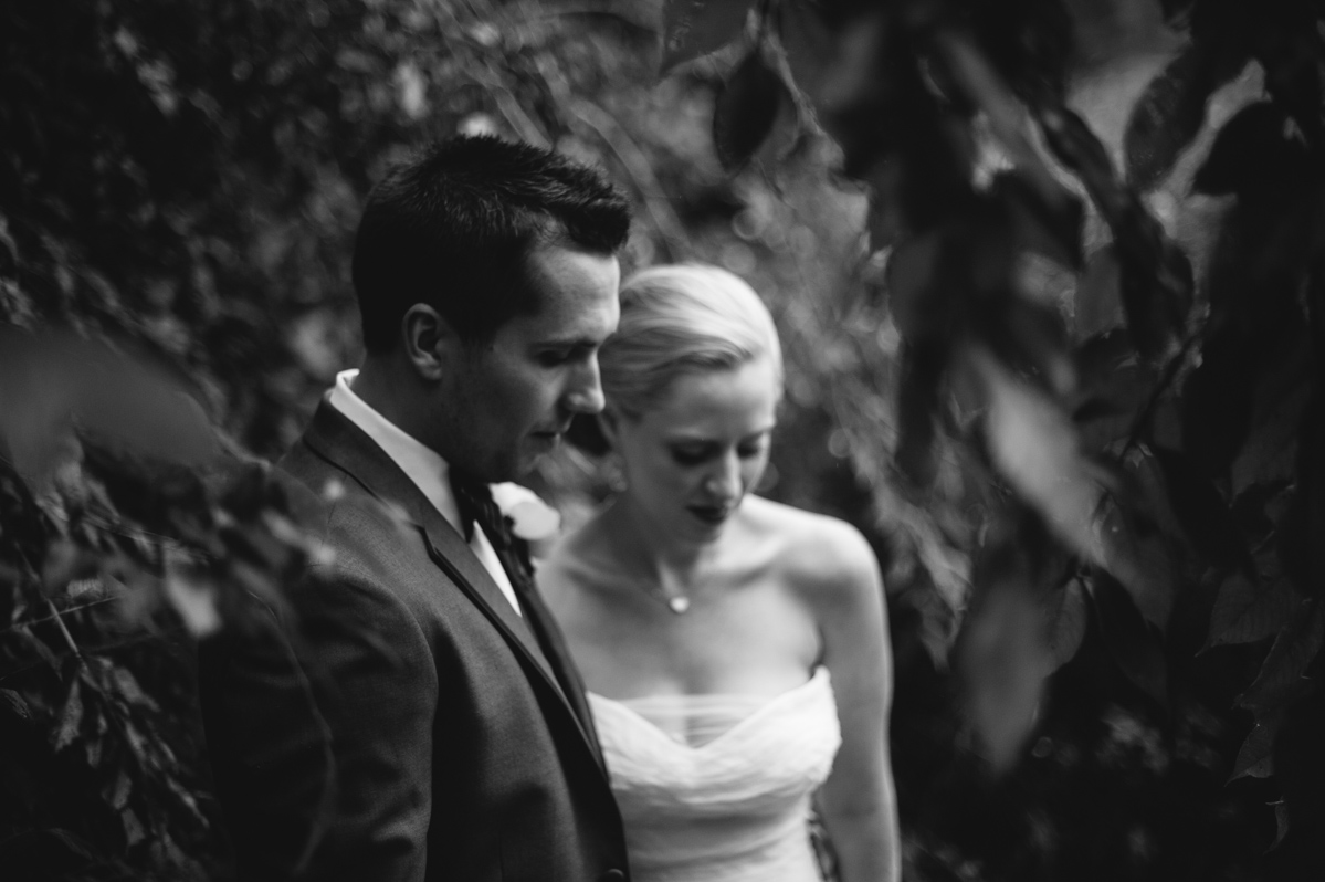 moody black and white photo of bride and groom