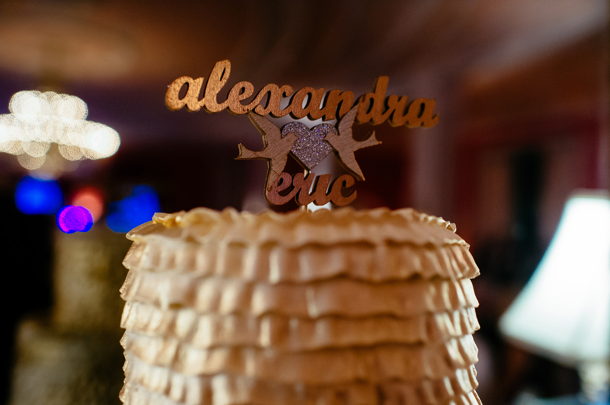 wedding cake with ruffles and gold