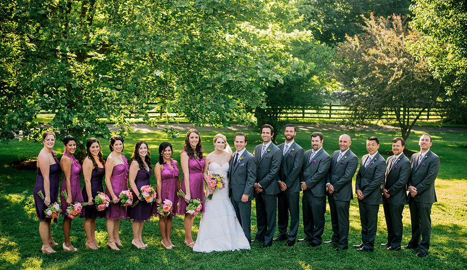 wedding party seven groomsment seven bridesmaids purple dresses