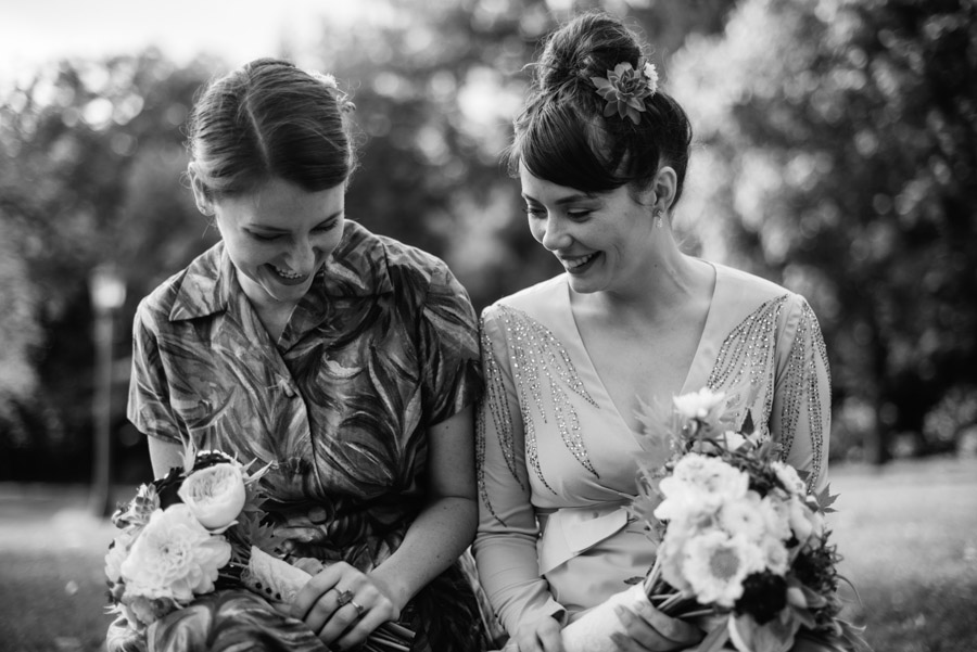 bride and maid of honor laughing real wedding moments