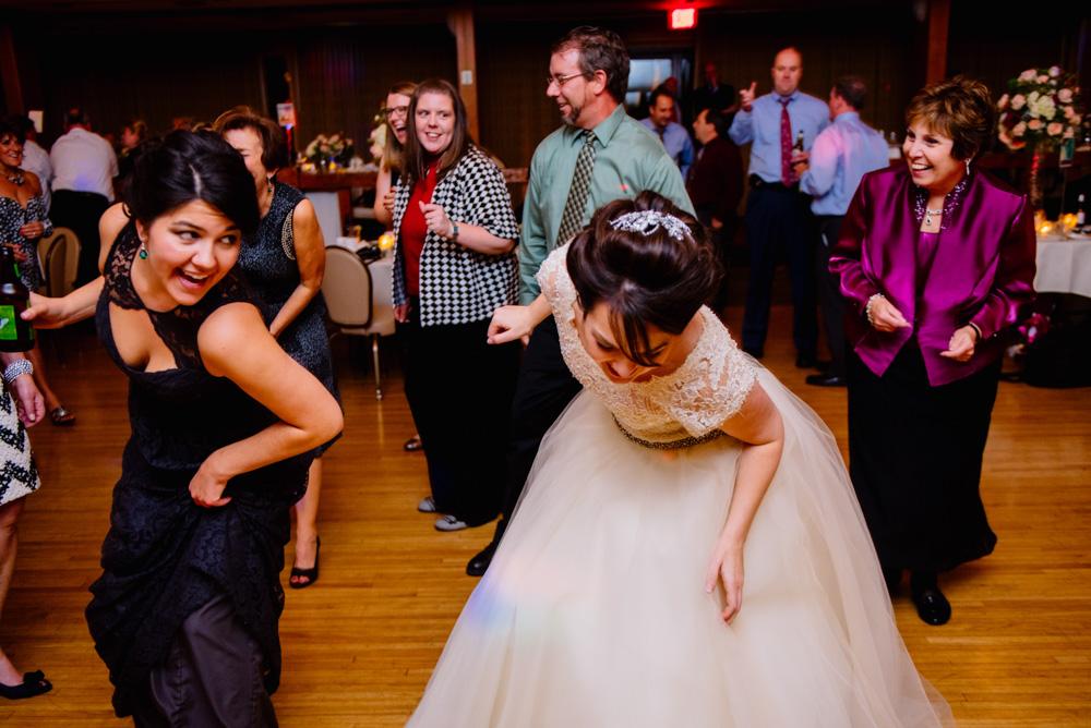 bride bridesmaids dancing during wedding reception