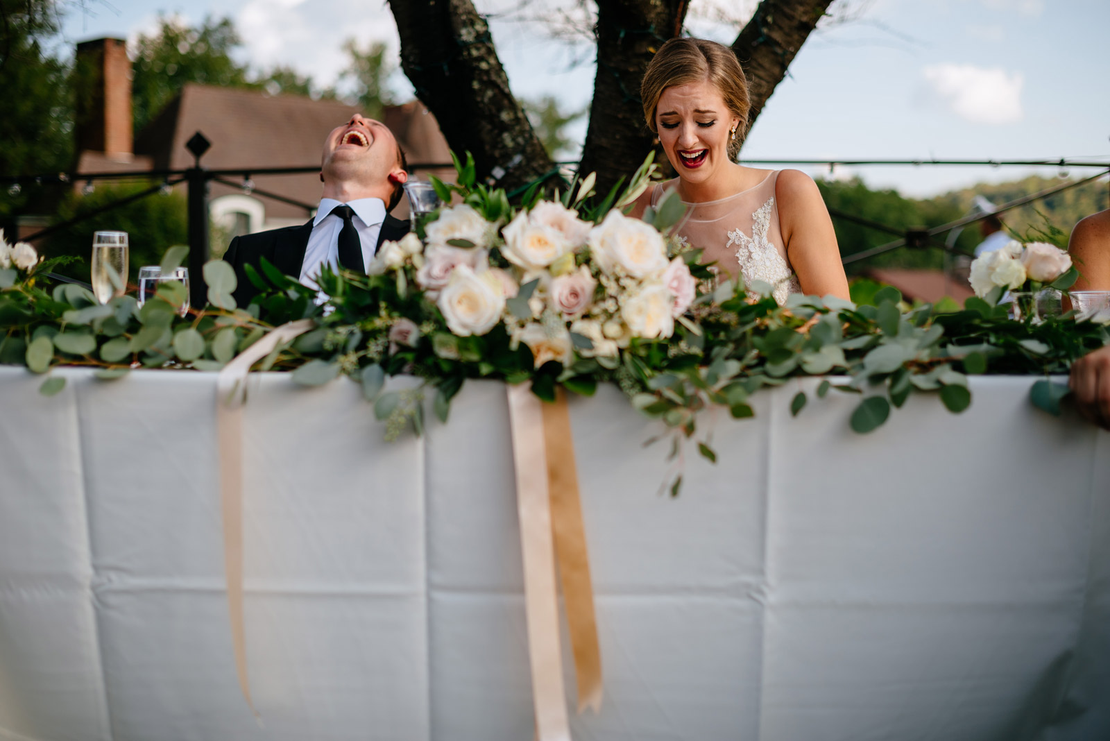 bride groom laughing during toasts zenner house wedding reception