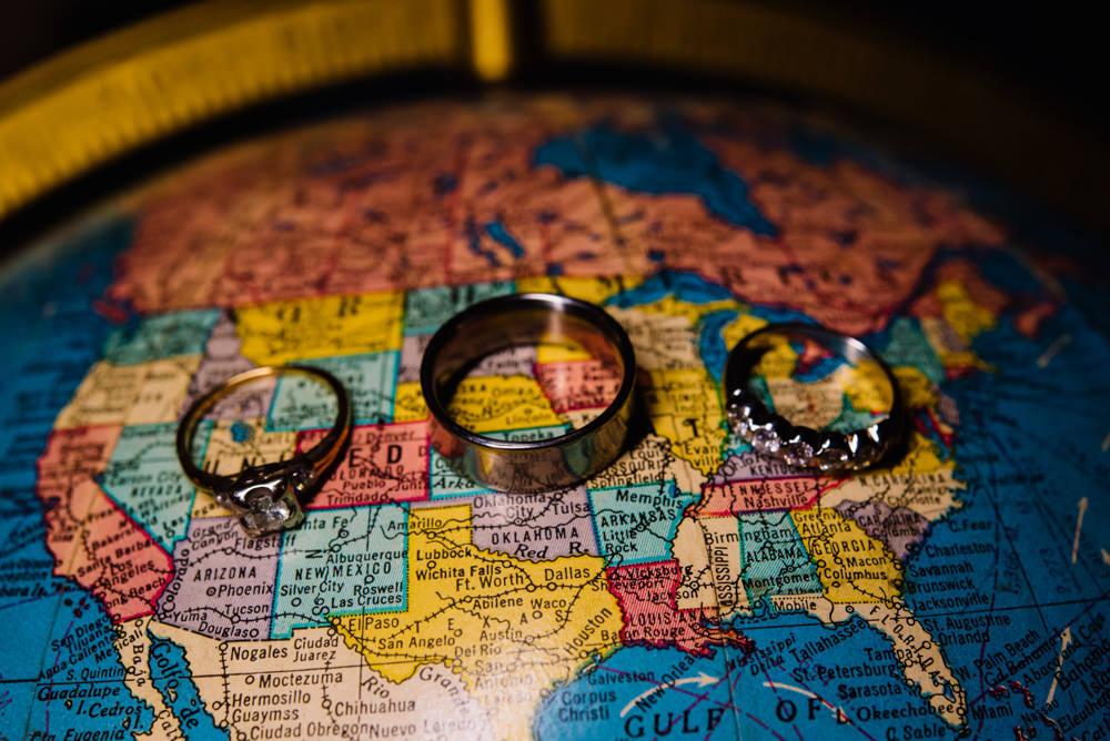 wedding rings on globe