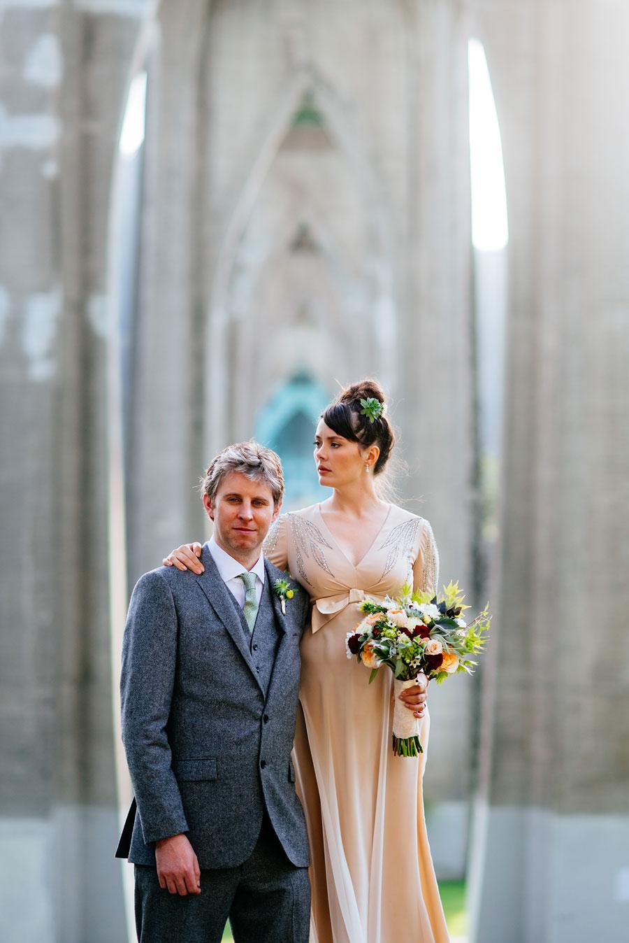 bride groom portraits under cathedral bridge portland oregon