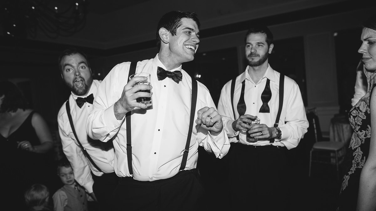 groomsmen cutting loose on dancefloor