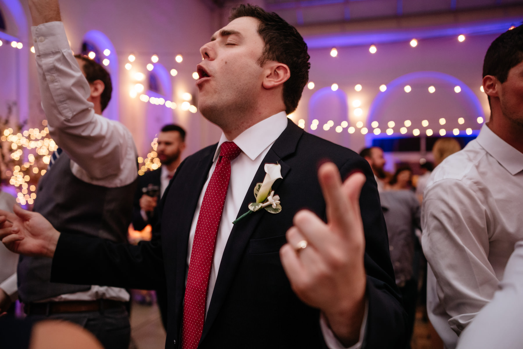 groom singing during wedding reception