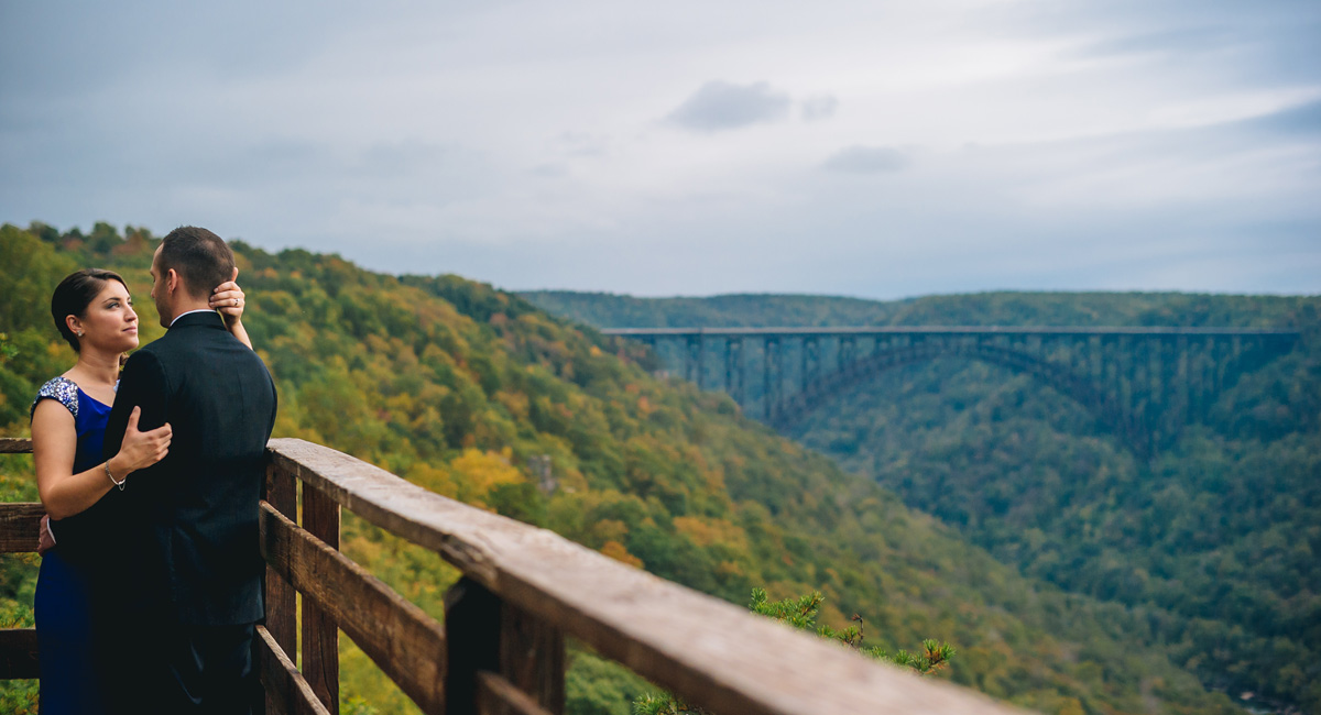bride and groom with new river gorge bridge by best west virginia wedding photographers the oberports