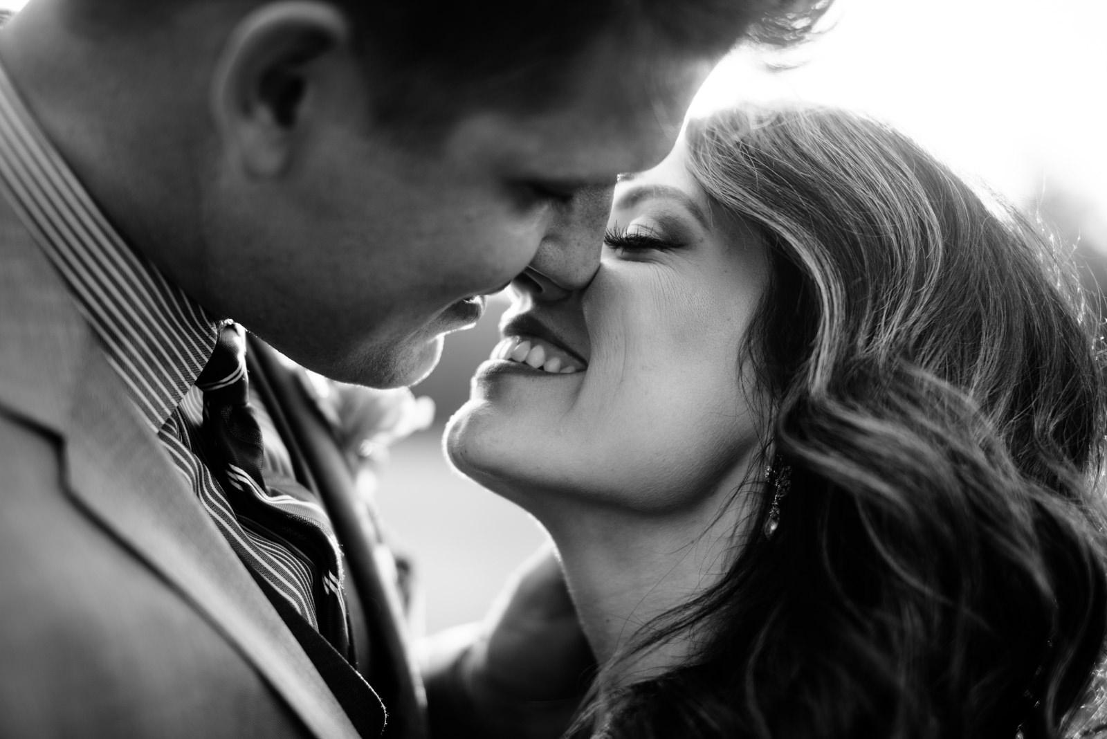 bride groom kissing black and white wedding photos