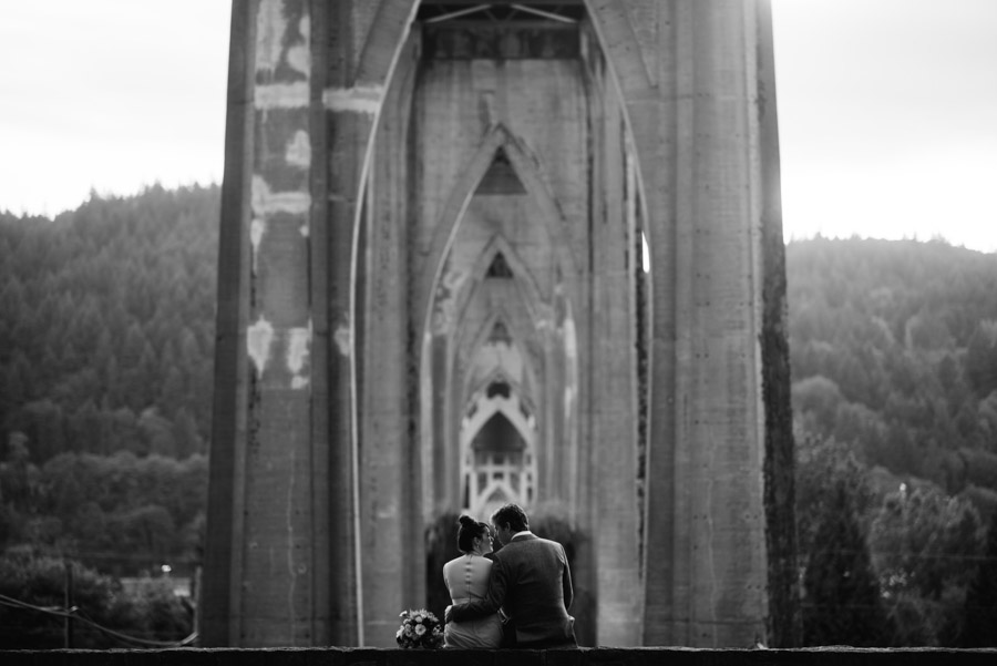 bride groom quiet moments under cathedral bridge portland oregon