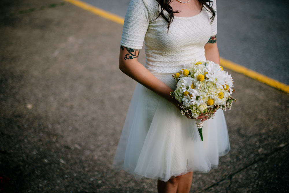 hip west virginia bride with tattoos and short dress