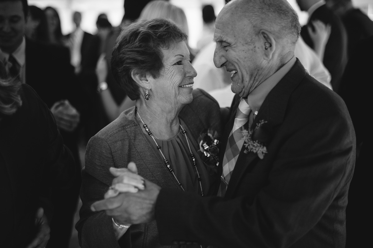 grooms parents dancing at wedding