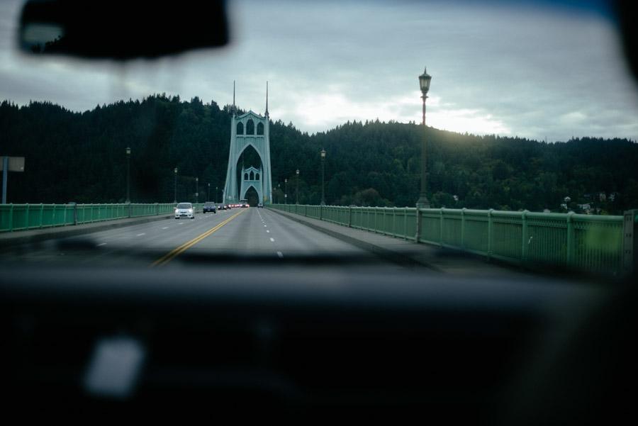 driving across st johns bridge cathedral park portland oregon