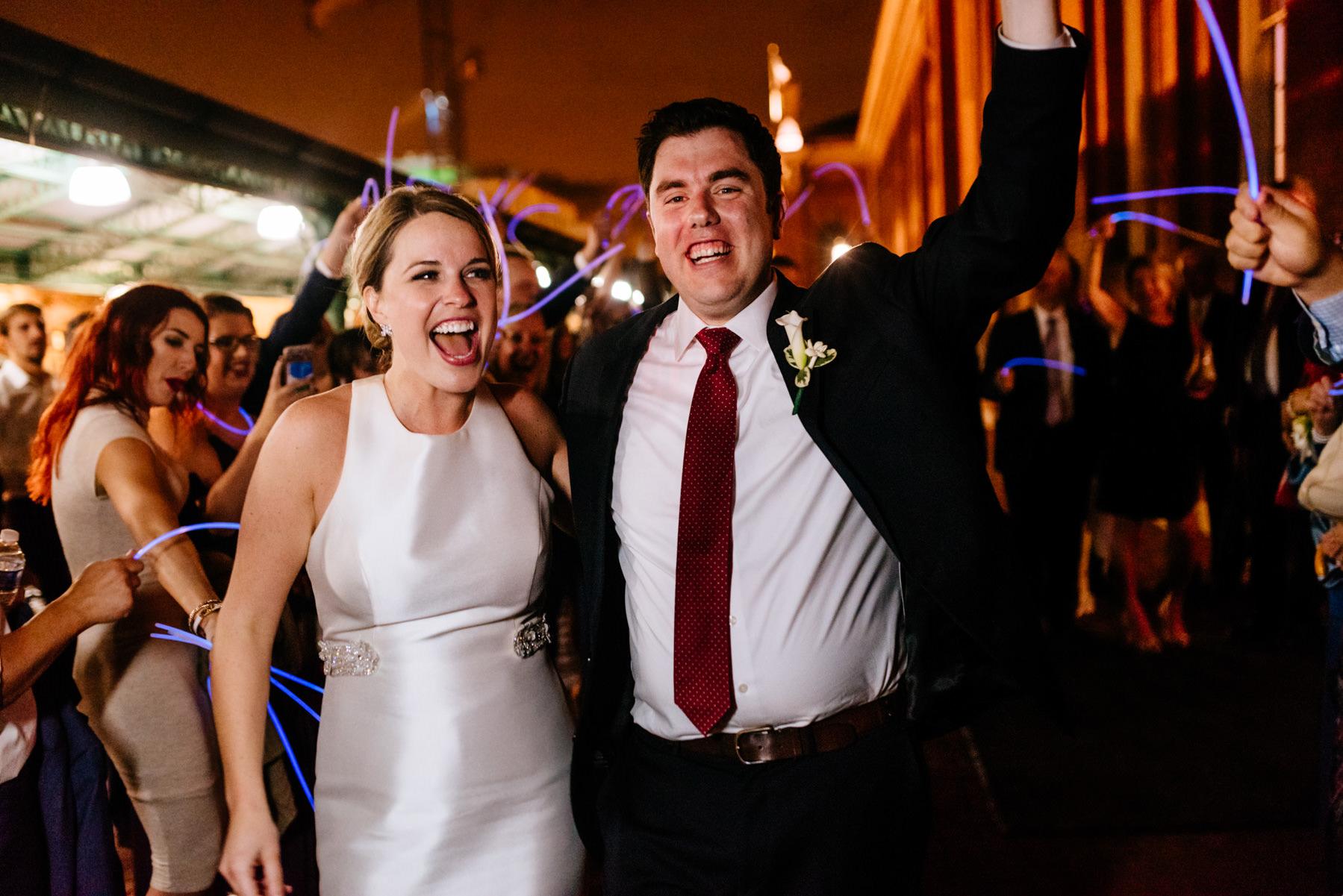 bride and groom exit eastern market wedding dc