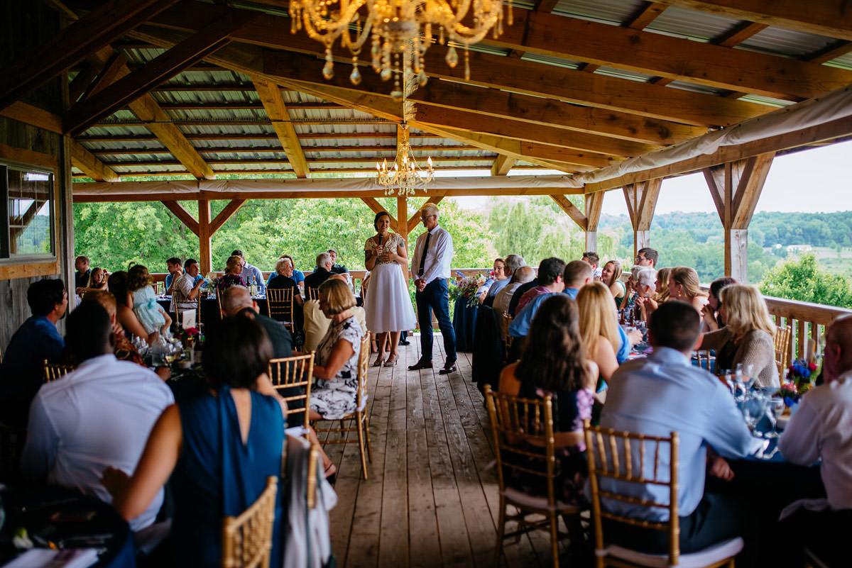 pittsburgh wedding rustic acres bride and groom toast
