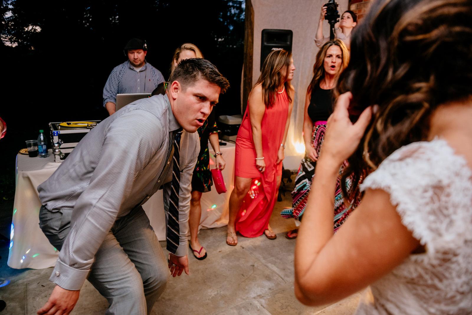 groom dancing wedding reception moment