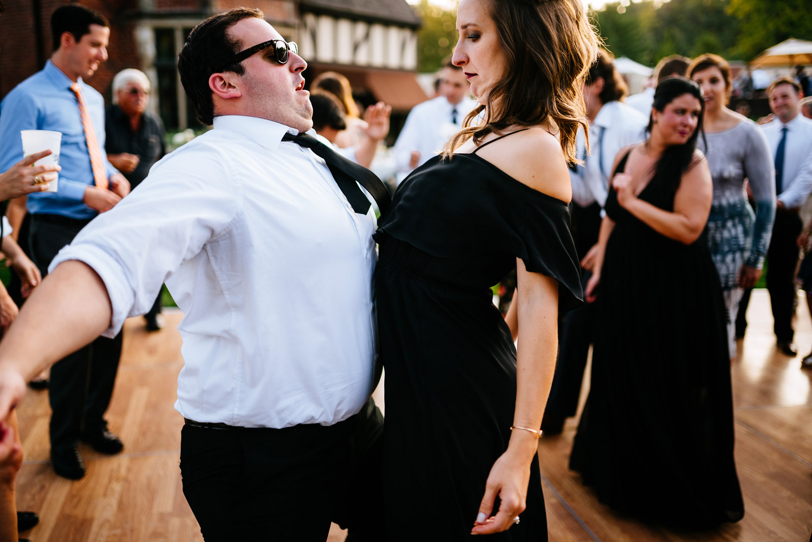 groomsman bridesmaid dancefloor chest bump