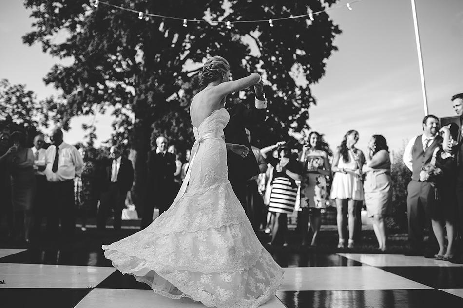 beautiful first dance twirl black and white wedding photojournalism