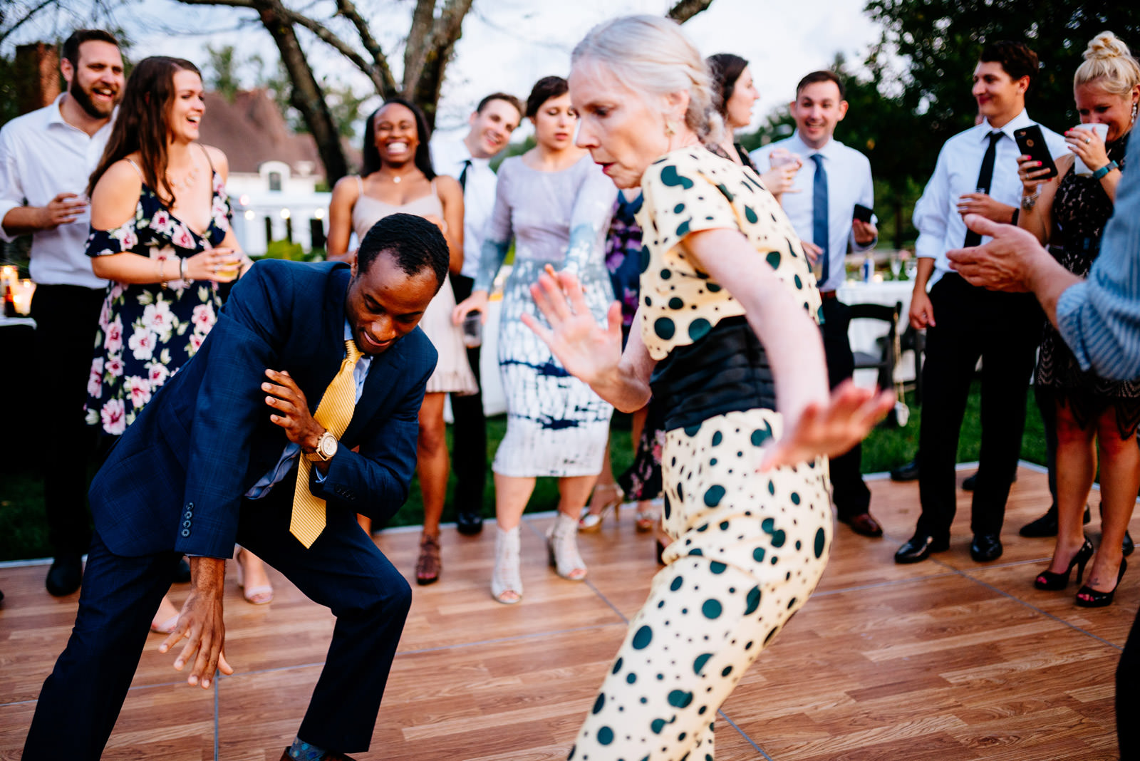 guests dancing during outdoor wedding reception