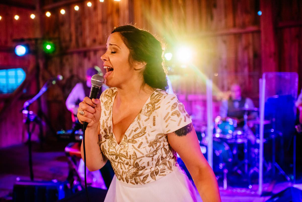 rustic acres wedding reception bride sings for groom