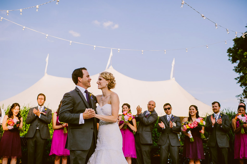 first dance wedding photography with wedding party in background