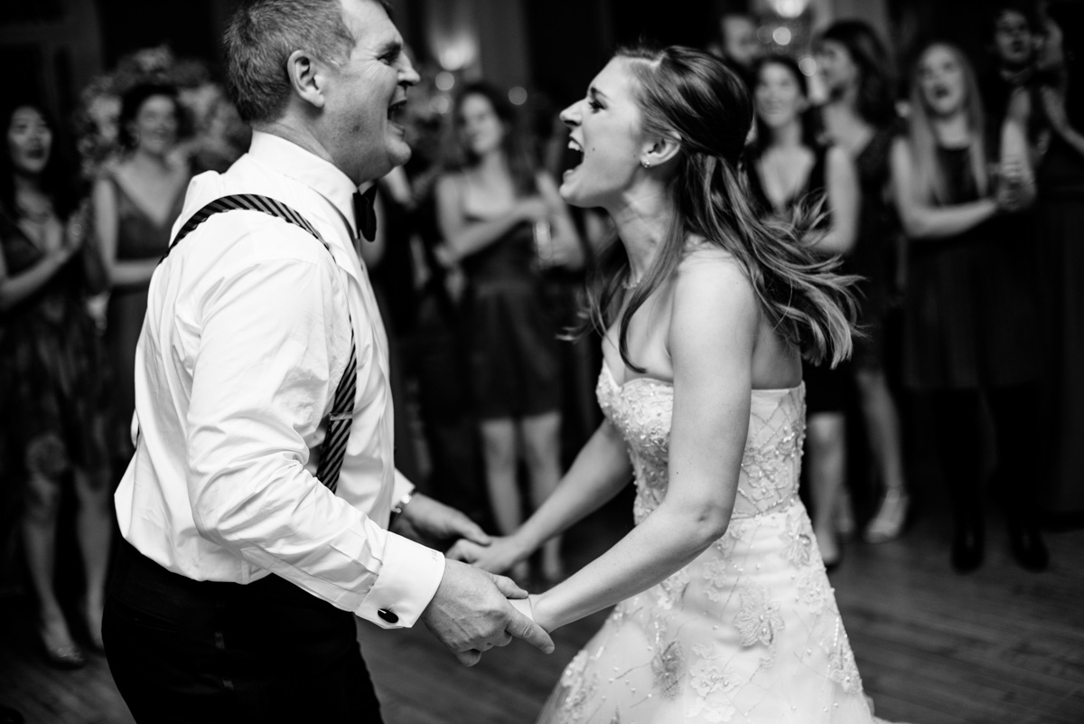 candid moment of bride dancing with her father at wedding reception at the greenbrier resort