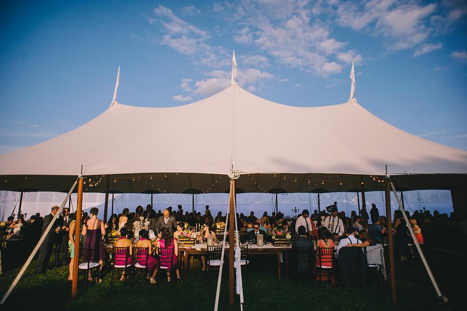 summer wedding reception classy tent at dusk