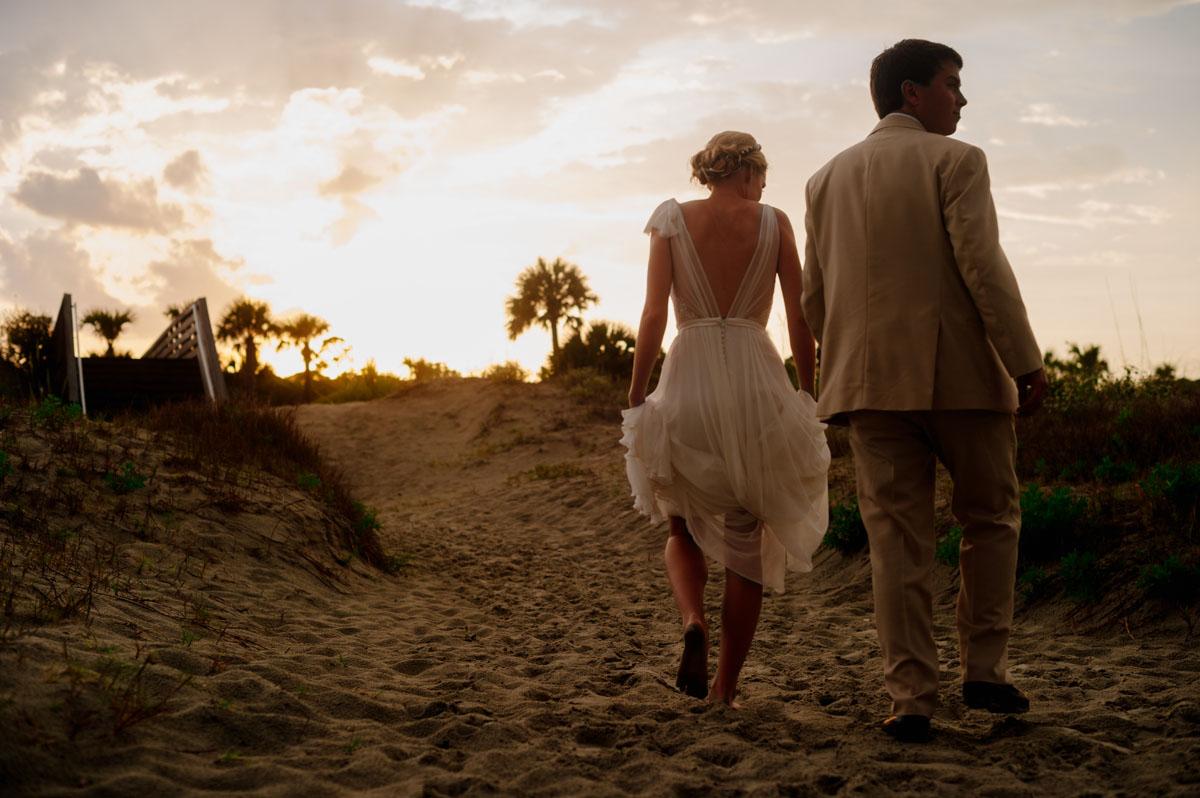 artistic sunset wedding portraits at the beach