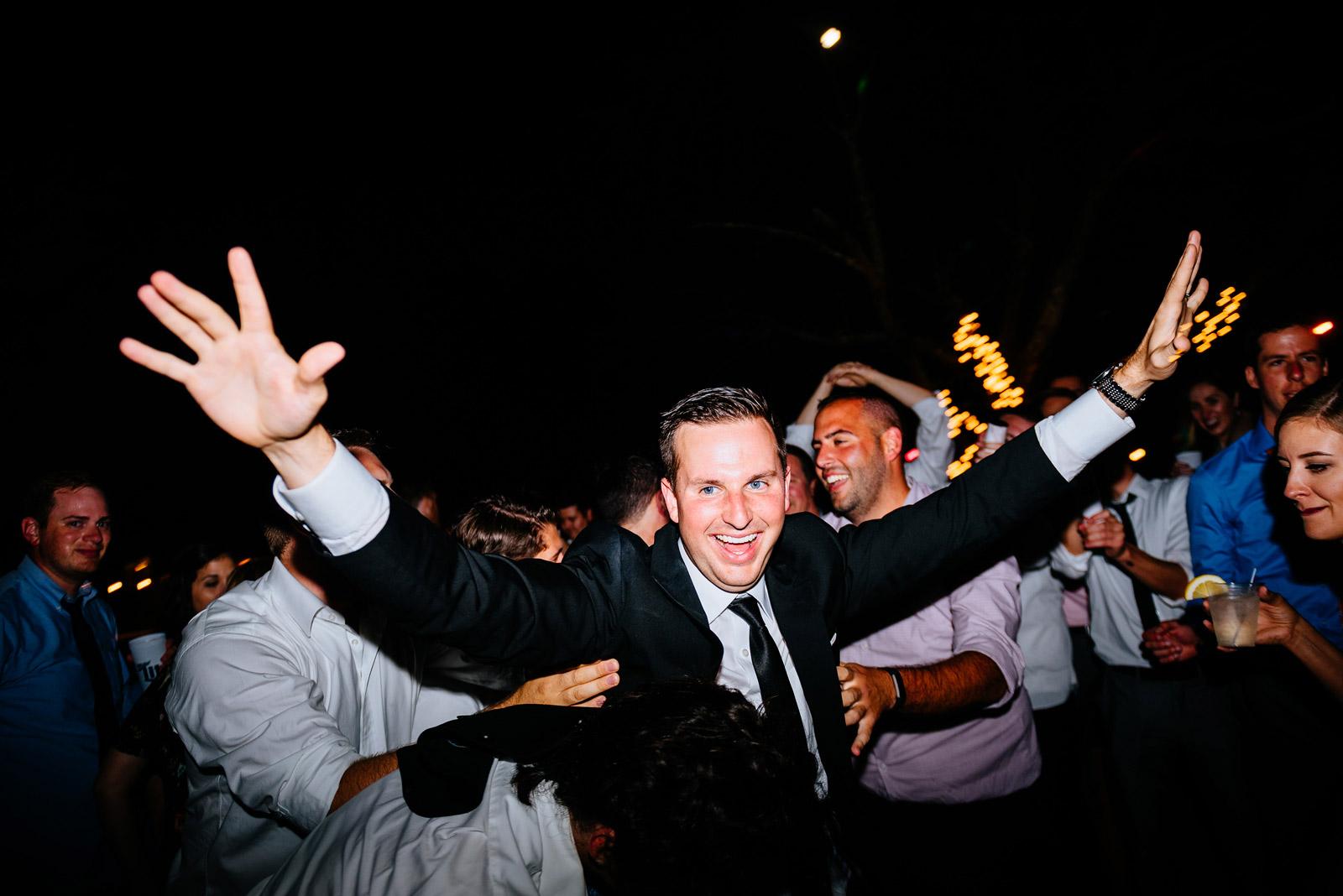 happy groom during wedding reception