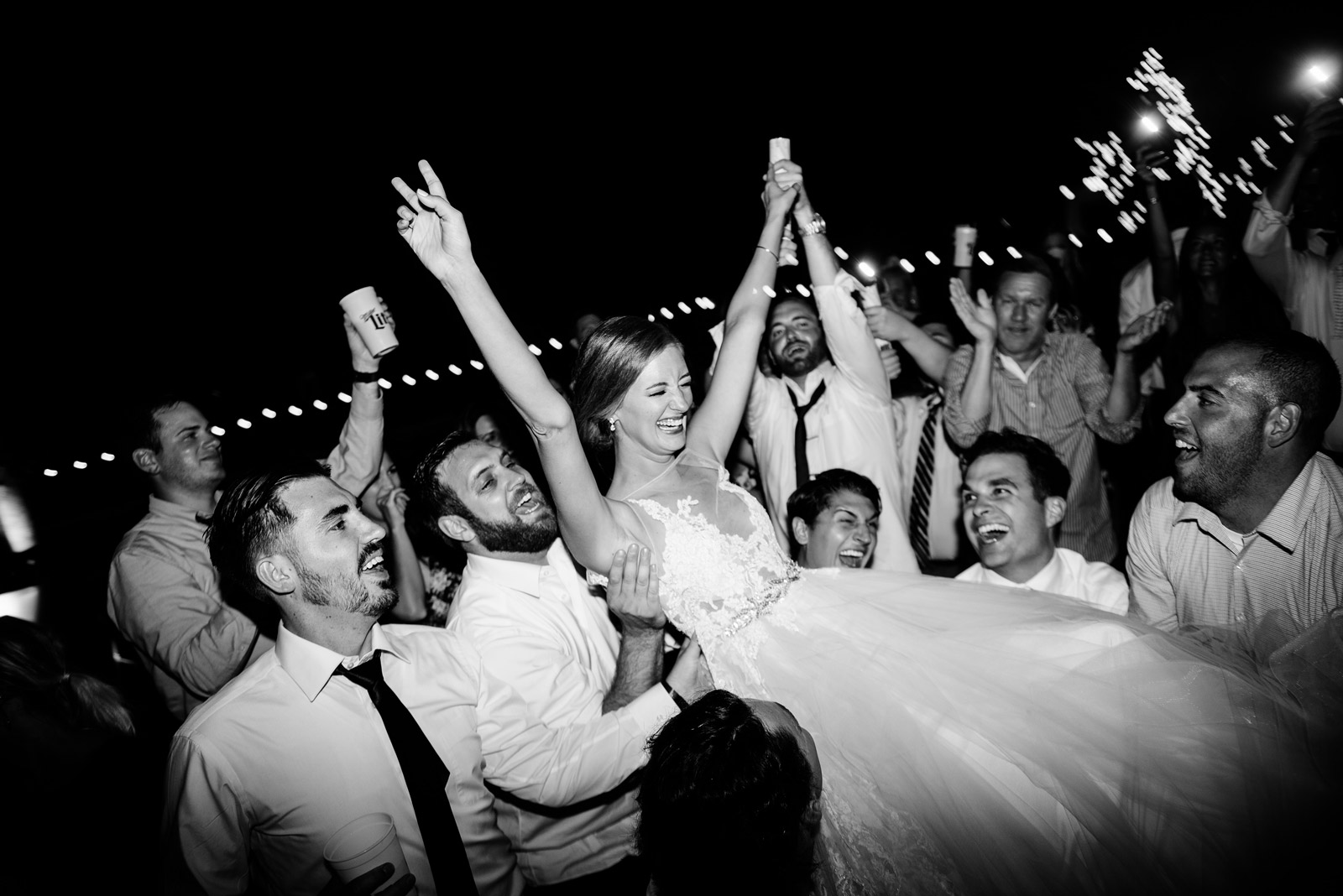 guests carrying bride during zenner house wedding reception