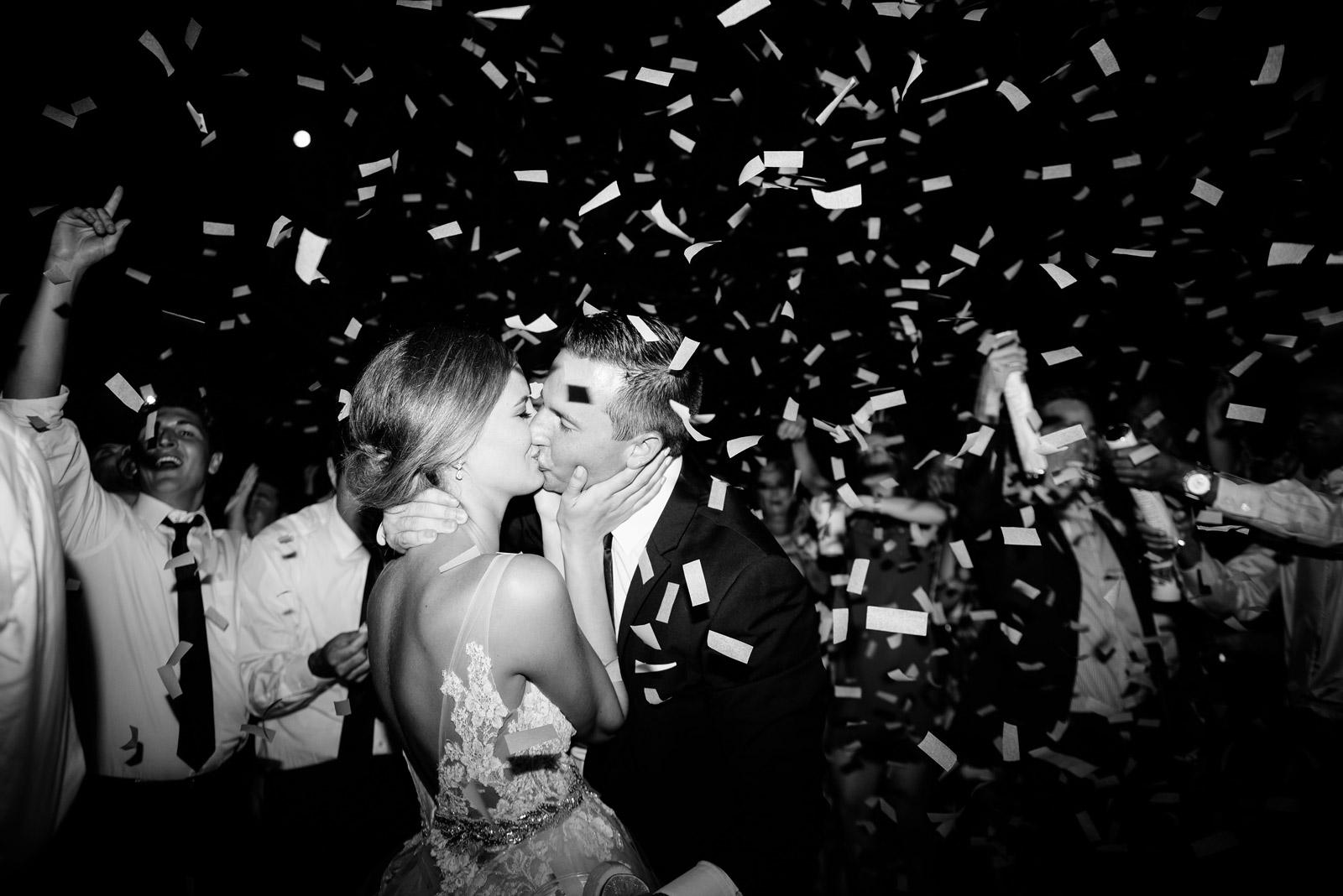 bride groom kissing confetti cannon zenner house wedding reception