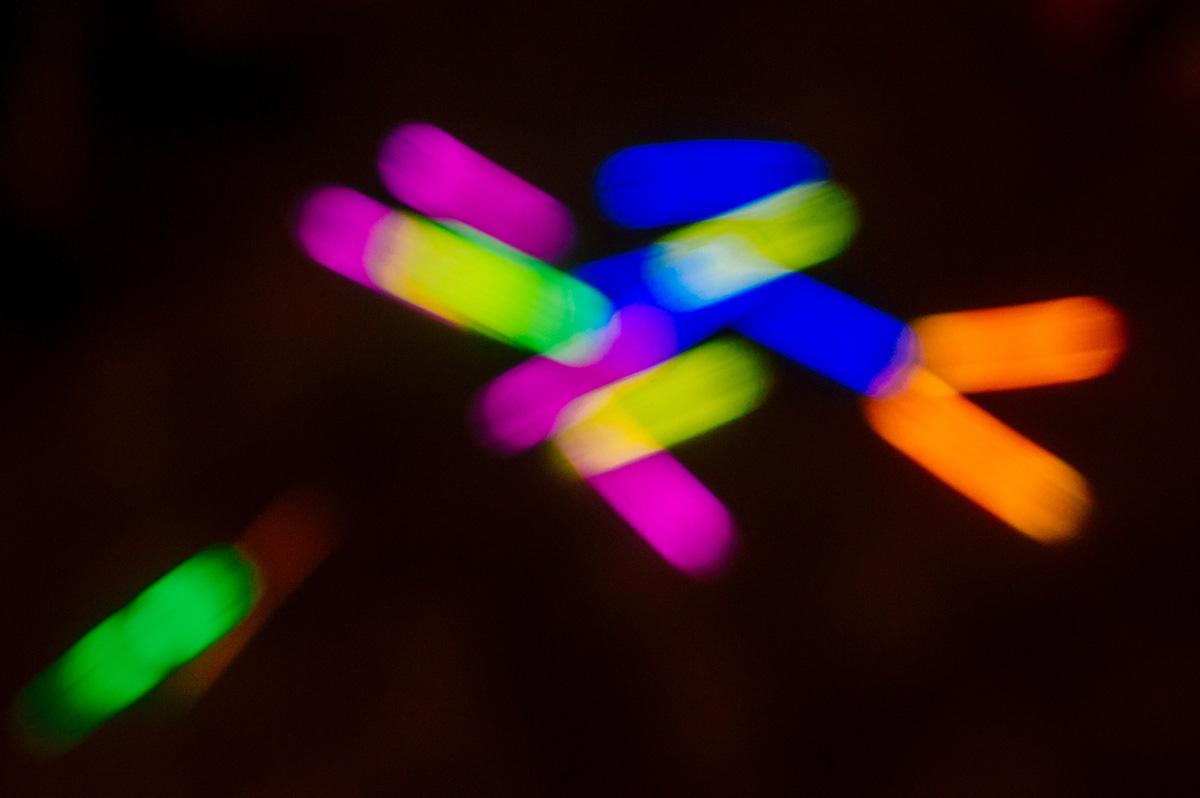 fine art wedding photojournalism glow sticks at reception