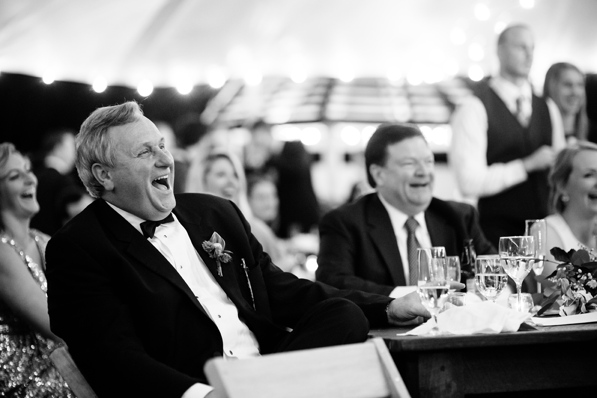 father of the bride laughs during toasts