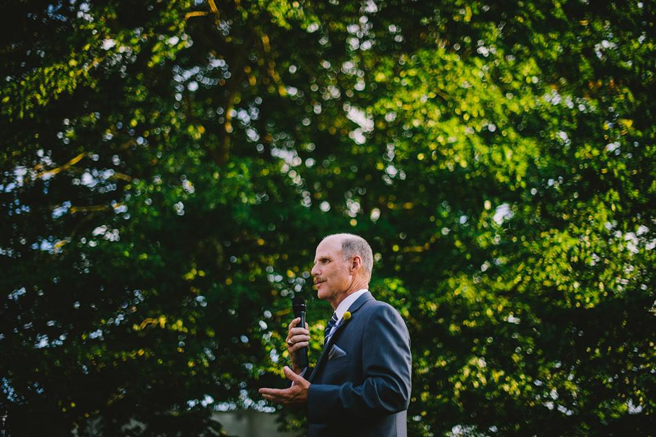 outdoor wedding reception photo dad speech