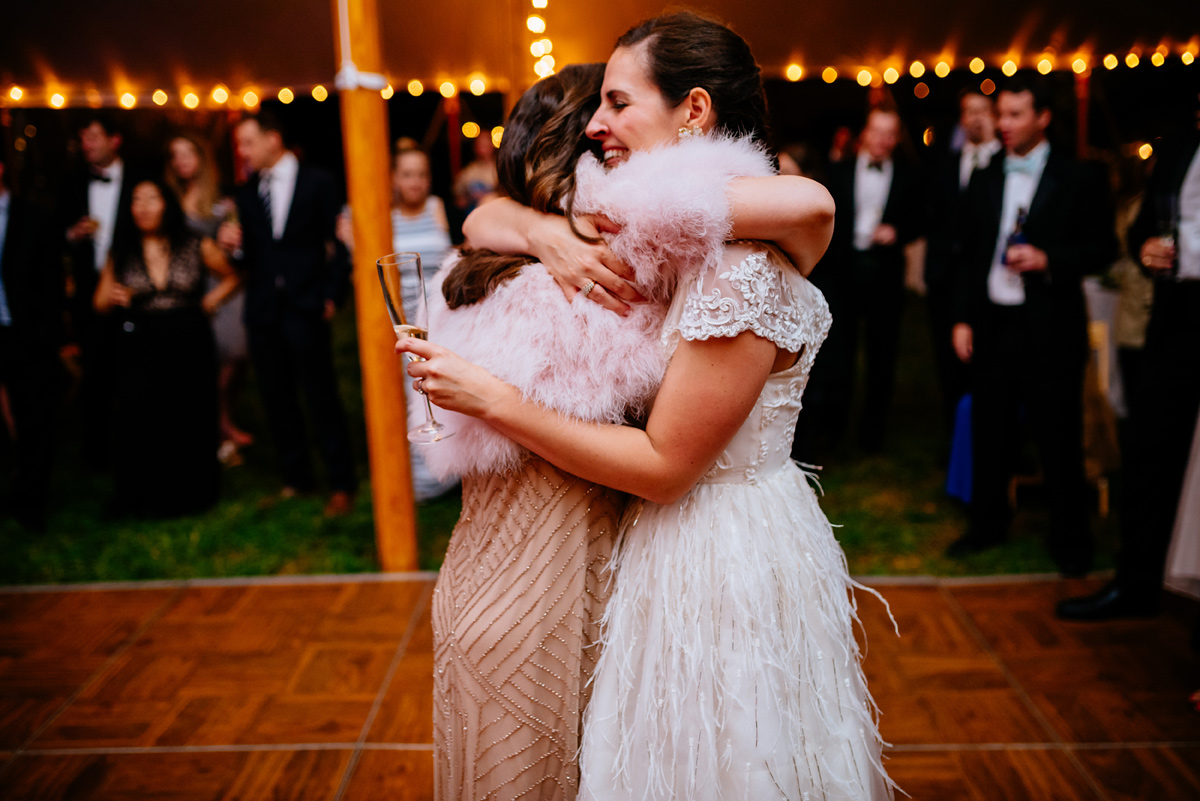 sisters hug on wedding day