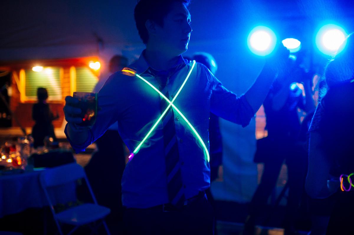 fun with glow sticks at wedding reception