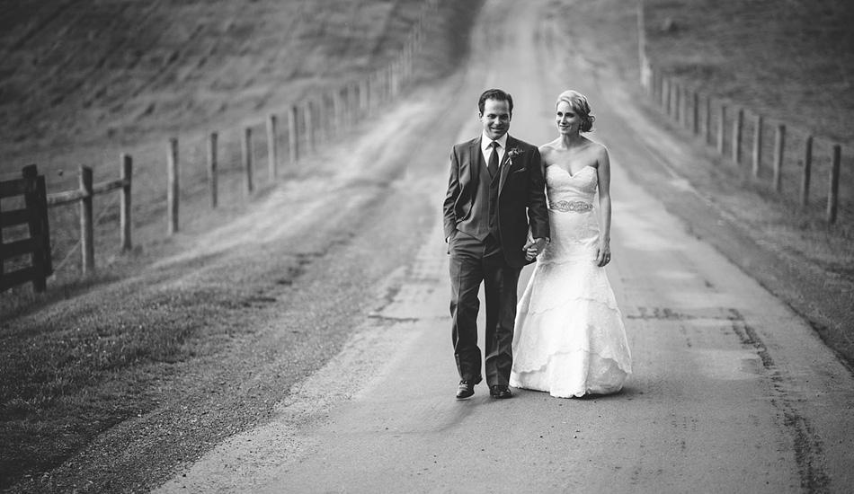bride and groom walking down road wedding portrait