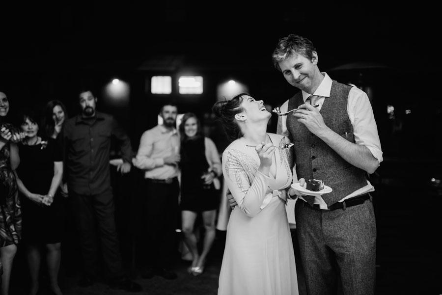 bride groom cake cutting paragon portland oregon wedding photojournalism1