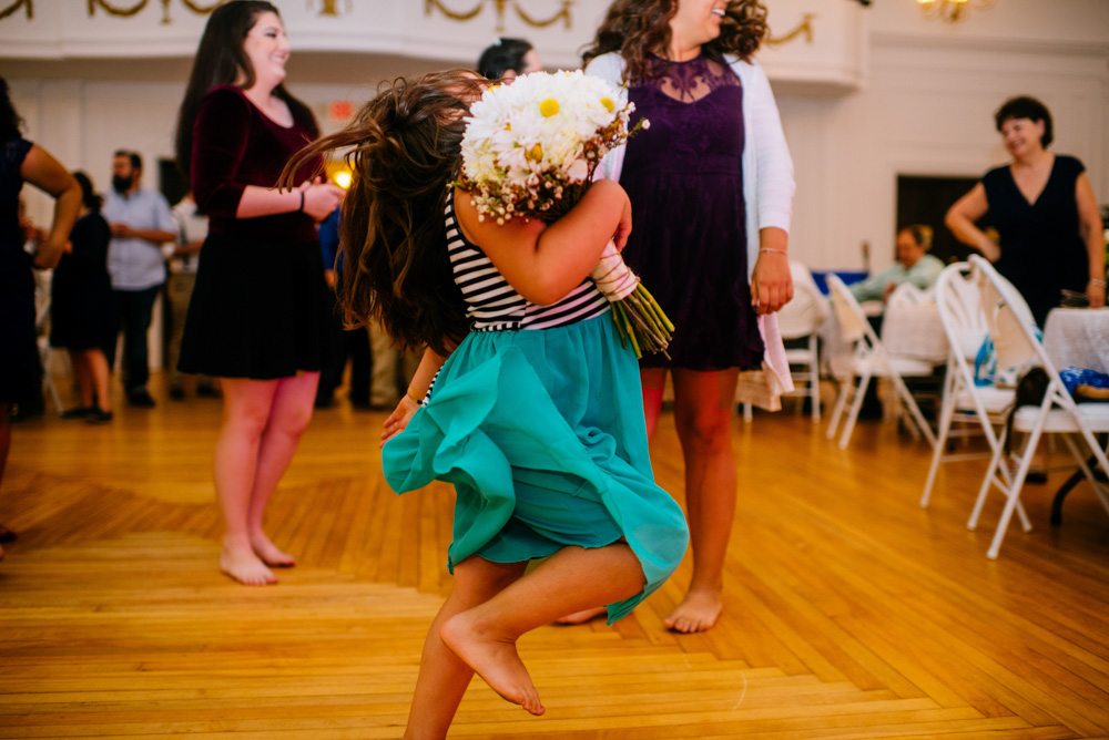 girl strutting with flowers after bouquet toss