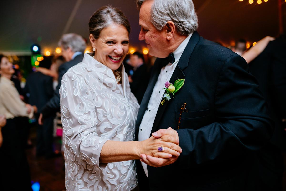 parents of the bride dancing at wedding reception